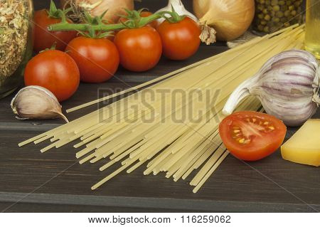 Preparing homemade pasta. Pasta and vegetables on a wooden table