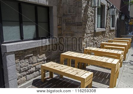 Wooden Tables And Benches On A City Street.