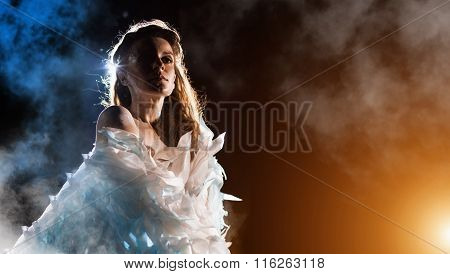 Portrait Of A White Angel On The Color Fog Background