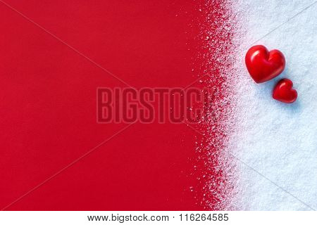 Two Red stone hearts on white snow winter