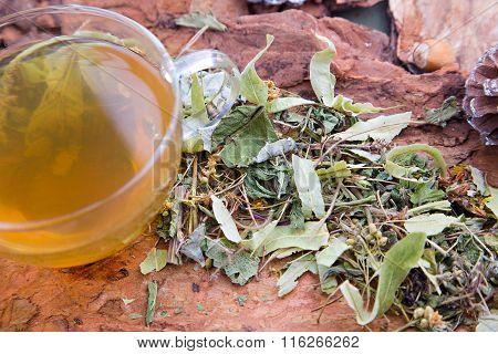Linden leaves with herbal tea on the clear cup