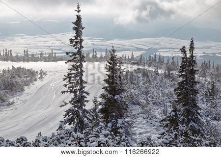 Ski Track On  Mountain Top Overlooking The Valley.