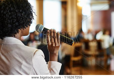 Female Speaker With Microphone