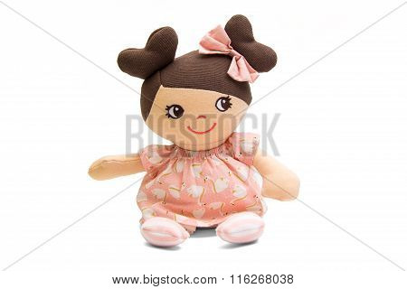 Baby doll soft toy isolated on white
