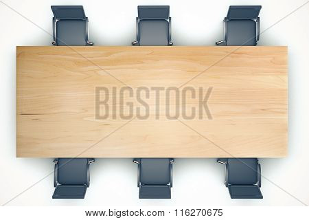 Top View On Conference Wooden Table And Black Chairs