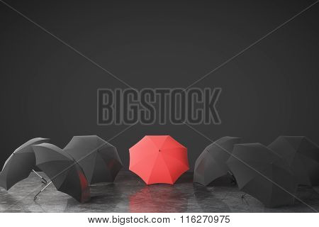 Be Unique Concept With Many Black Umbrellas And One Red On Concrete Floor At Black Wall Background