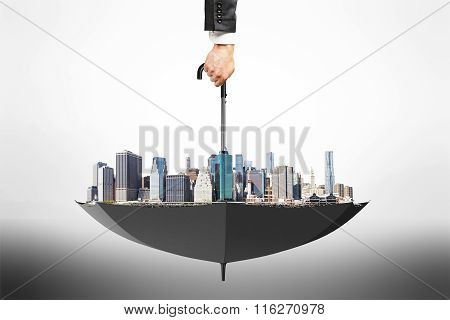 City District Area In Black Flipped Over Umbrella And Man Hand