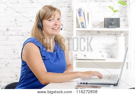 Portrait Of Smiling Cheerful Support Phone Operator In Headset.