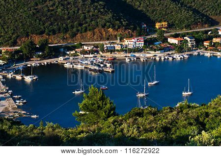 Porto Koufo harbor with a lot of anchored sailboats at sunset, west coast of Sithonia