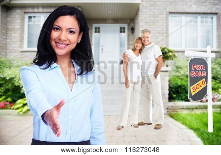 Asian Real Estate agent woman near new house.