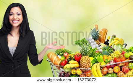 Asian woman with Grocery shopping cart.