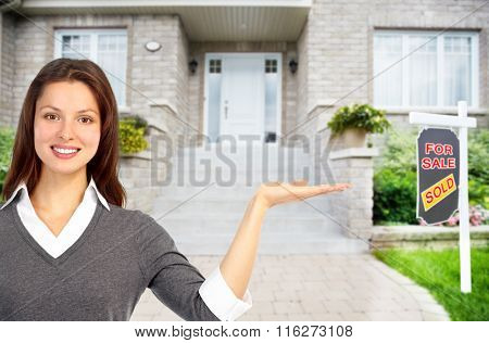 Real Estate agent woman near new house.