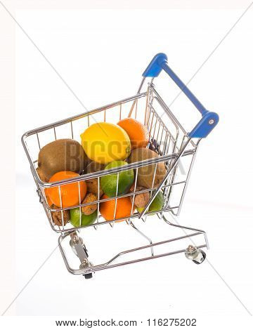 Shopping cart filled with fruits on a white background
