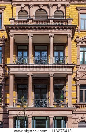 facade of an old historic house in Wiesbaden with typical balcony