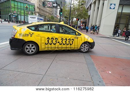 Yellow Taxicab Making Turn On Streets Of San Francisco, California