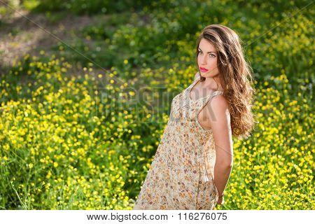Beautiful Young Girl Among Yellow Flowers