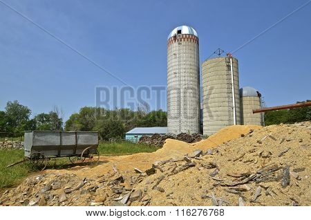 Grain wagon, sawdust, and silos