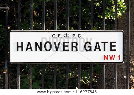 Hanover Gate road plate hung to garden fence in central London.