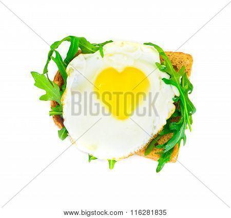 Scrambled Eggs with Arugula in Whole Grain Bread in Form of Hear