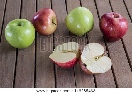 Ripe apples on wooden background.