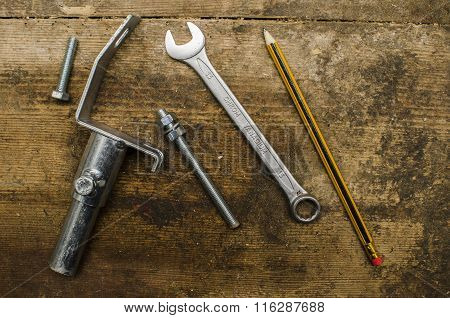 Tools and parts on old wooden table
