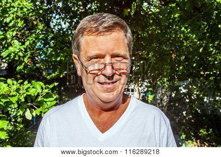Happy Attractive Man In The Garden