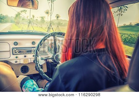 Asia Young Woman Driving Vintage Car