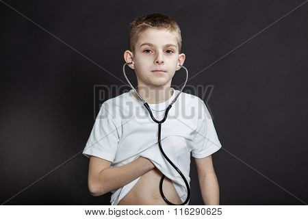 Young Boy Checking His Heart Beat With Stethoscope