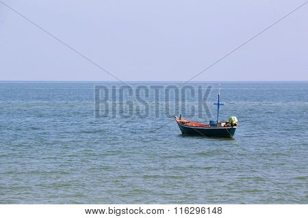 Single Mini Fishery Boat Floating On Sea