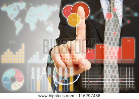 Businessman touching interface of touchscreen with graphs and analytical data