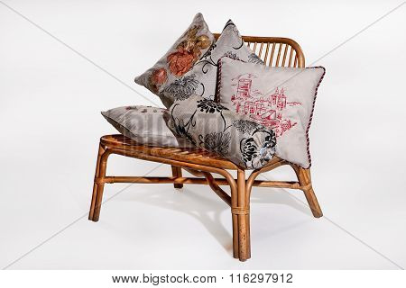 Decorative Pillows On A Wicker Bench