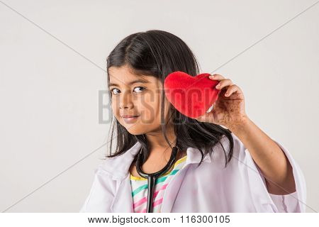 small indian girl doctor with stuffed heart