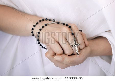 Young Woman's Hands With A Rosary