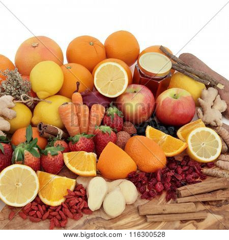 Large antioxidant food selection for cold remedy with foods on an olive wood board over white background.