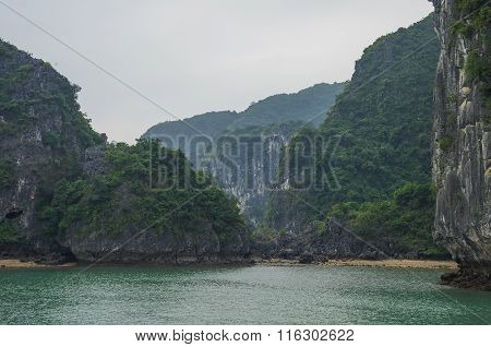 Beautiful Limestone Mountain Scenery At Ha Long Bay, North Vietnam. Cloudy Winter Weather
