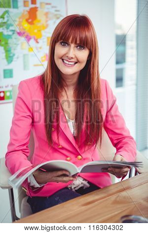 Portrait of a hipster businesswoman at her desk in office