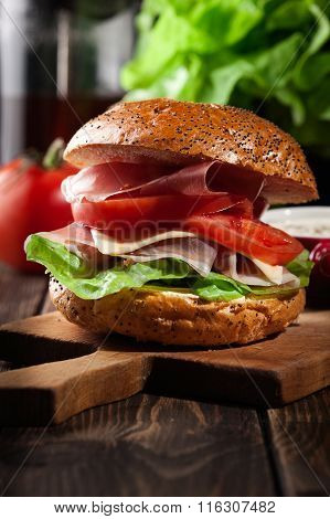 Delicious Sandwich With Prosciutto Ham, Cheese And Vegetables
