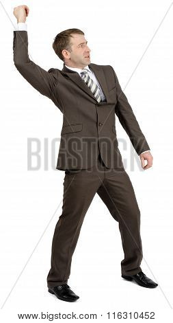 Businessman holding invisible spear