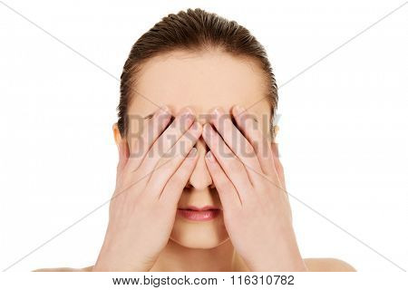 Woman covering her eyes.