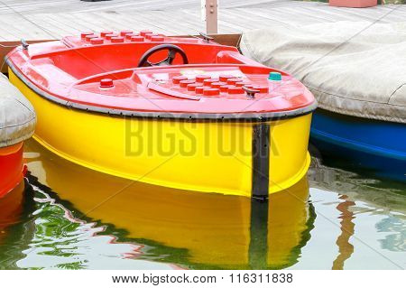 Colorful Plastic Boat Parked In The Port.