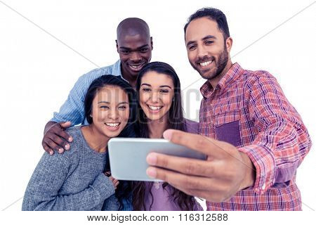 Smiling multi-ethnic friends taking selfie while standing against white background