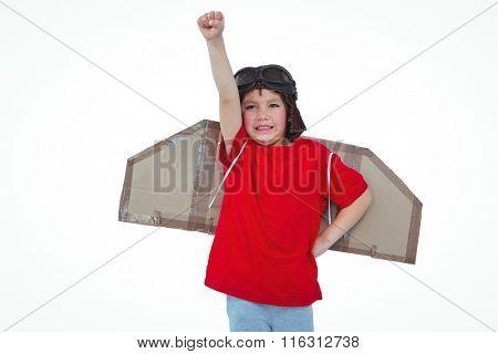 Boy raising fist pretending to be a pilot on white screen