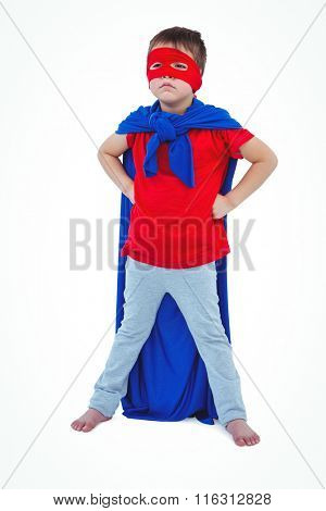 Masked boy pretending to be superhero on white screen