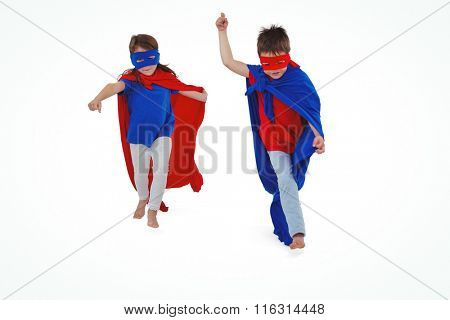 Masked kids walking pretending to be superheroes on white screen