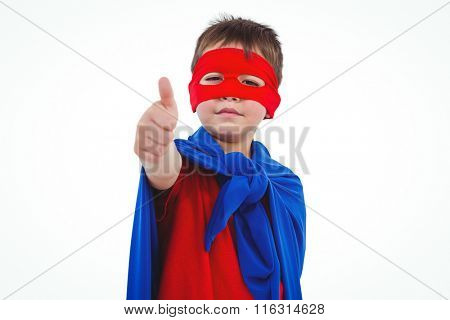 Masked boy showing thumb up pretending to be superhero on white screen