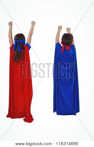 Rear view of masked kids pretending to be superheroes on white screen