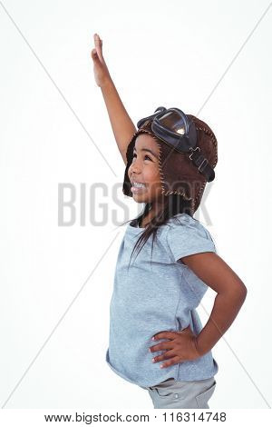 Side view of girl with outstretched arm pretending to be pilot on white screen
