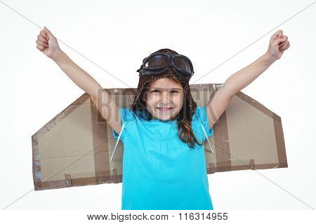 Smiling girl with outstretched arms pretending to be pilot on white screen