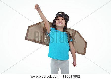 Cute girl with fake wings pretending to be pilot on white screen