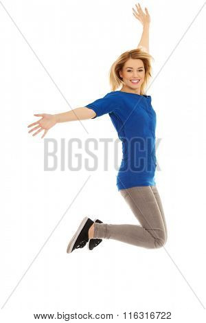 Young casual woman jumping.